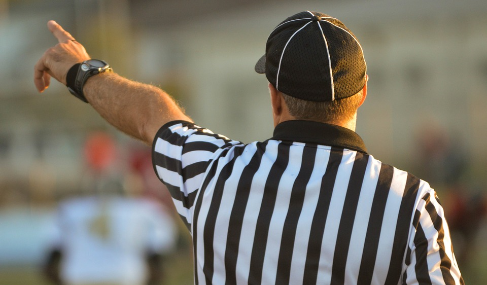 Referee pointing out the rules of online stock trading.