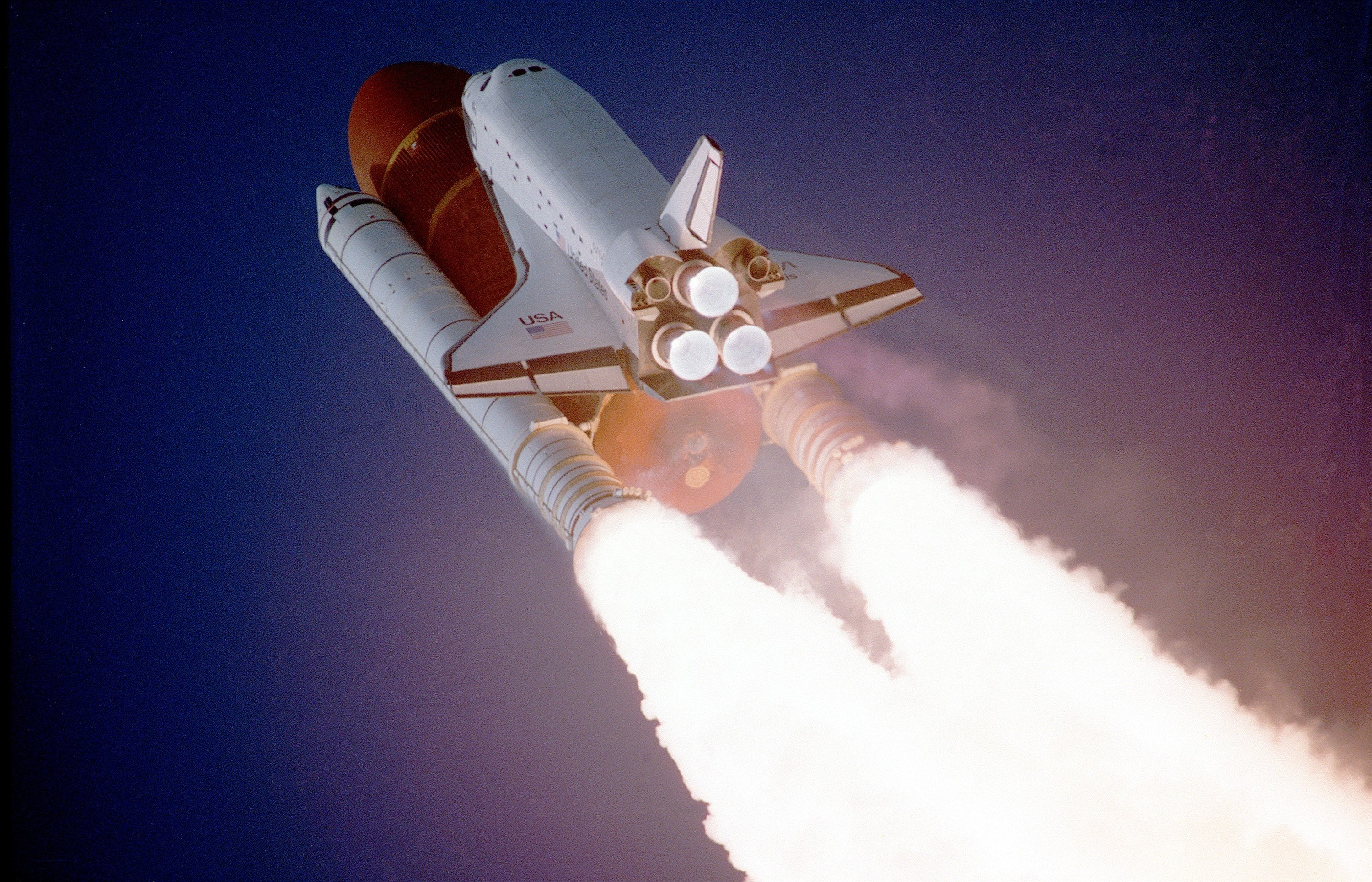 Image of space shuttle blasting upward gives visual of boosting profits when trading stocks online.