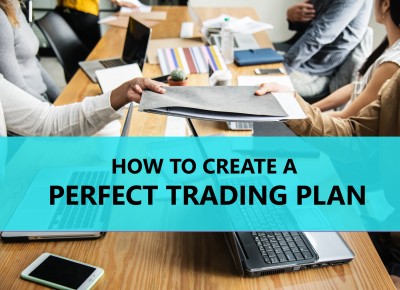 Stock traders at work sharing ideas on how to create the perfect trading plan.